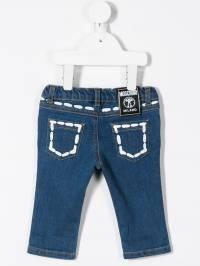 Moschino Kids - джинсы скинни с принтом тромплей 69ULXE93935593390000