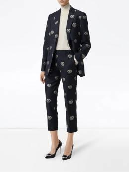 Burberry - укороченные брюки строгого кроя с фирменными эмблемами 89899356635600000000