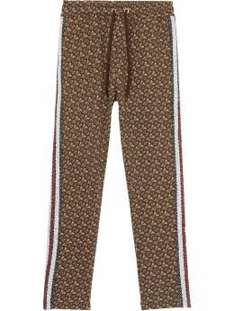Burberry - спортивные брюки с монограммой и лампасами в полоску 85559596993500000000