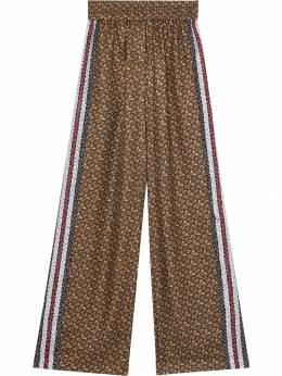 Burberry - брюки с монограммой и лампасами в полоску 89569596993000000000