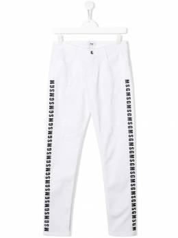 Msgm Kids - джинсы с эффектом потертости и логотипом 55893395359000000000