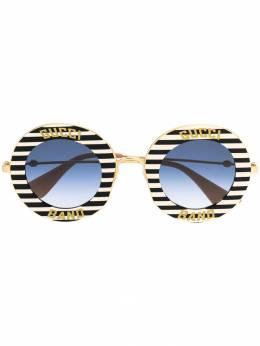 Gucci Eyewear striped circle frame sunglasses 470459I3330