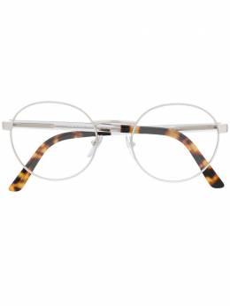 Prada Eyewear очки в круглой оправе VPR52X